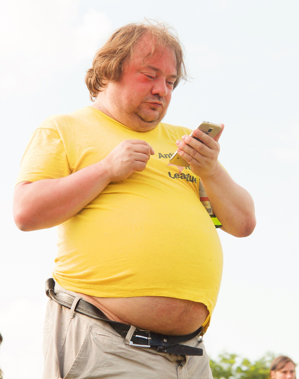 obese man with mobile phone
