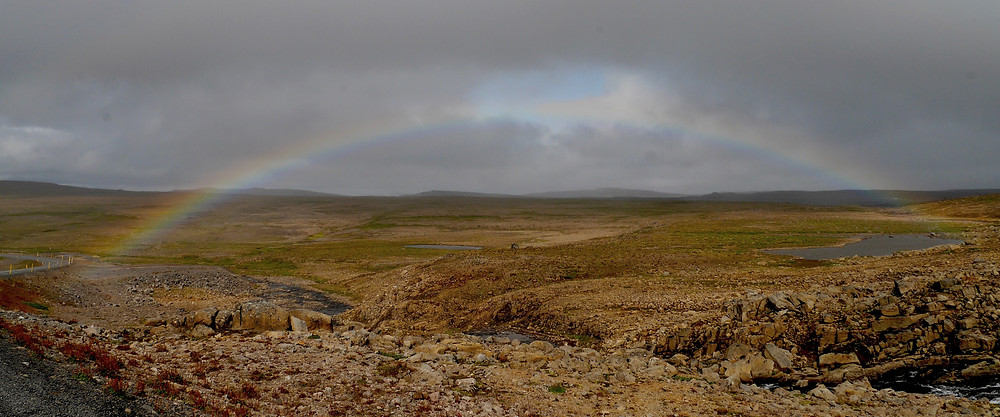 beautiful rainbow nearby Drangajökull Glacier, Iceland scenic view