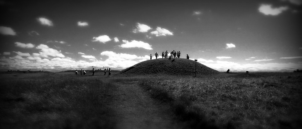 Mound of hostages, black and white images, people standing on top of it.