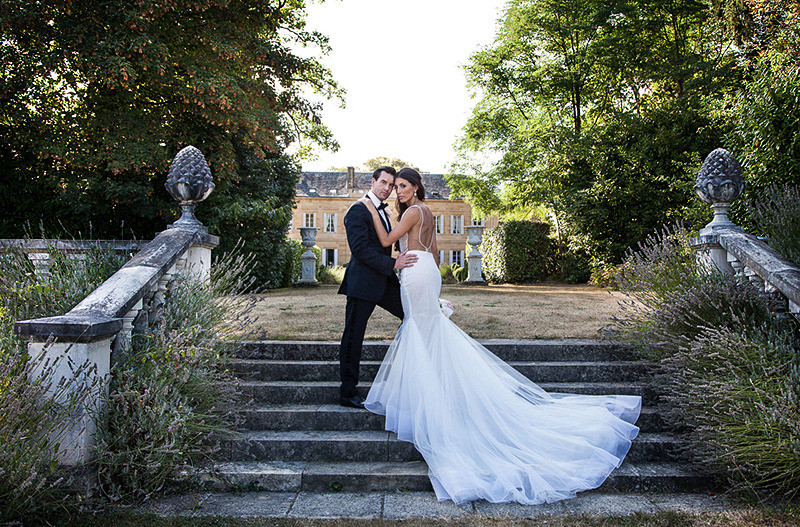 Bride and groom on steps at chateau la durantie