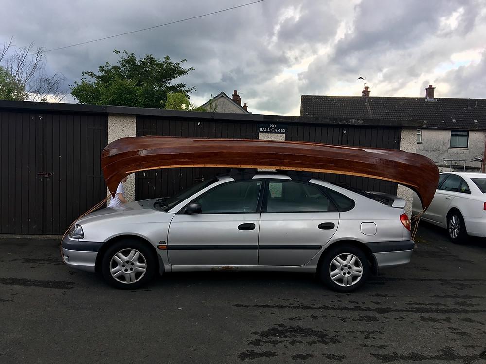 Canoe balanced on inflatable roof-bars.