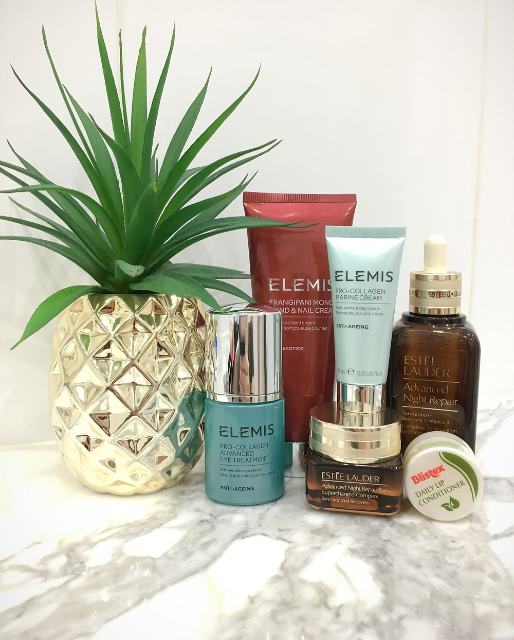 Essential in flight beauty skin care items. Elemis pro-collagen eye treatment, pro-collagen day cream, estee laurder advanced night repair serum