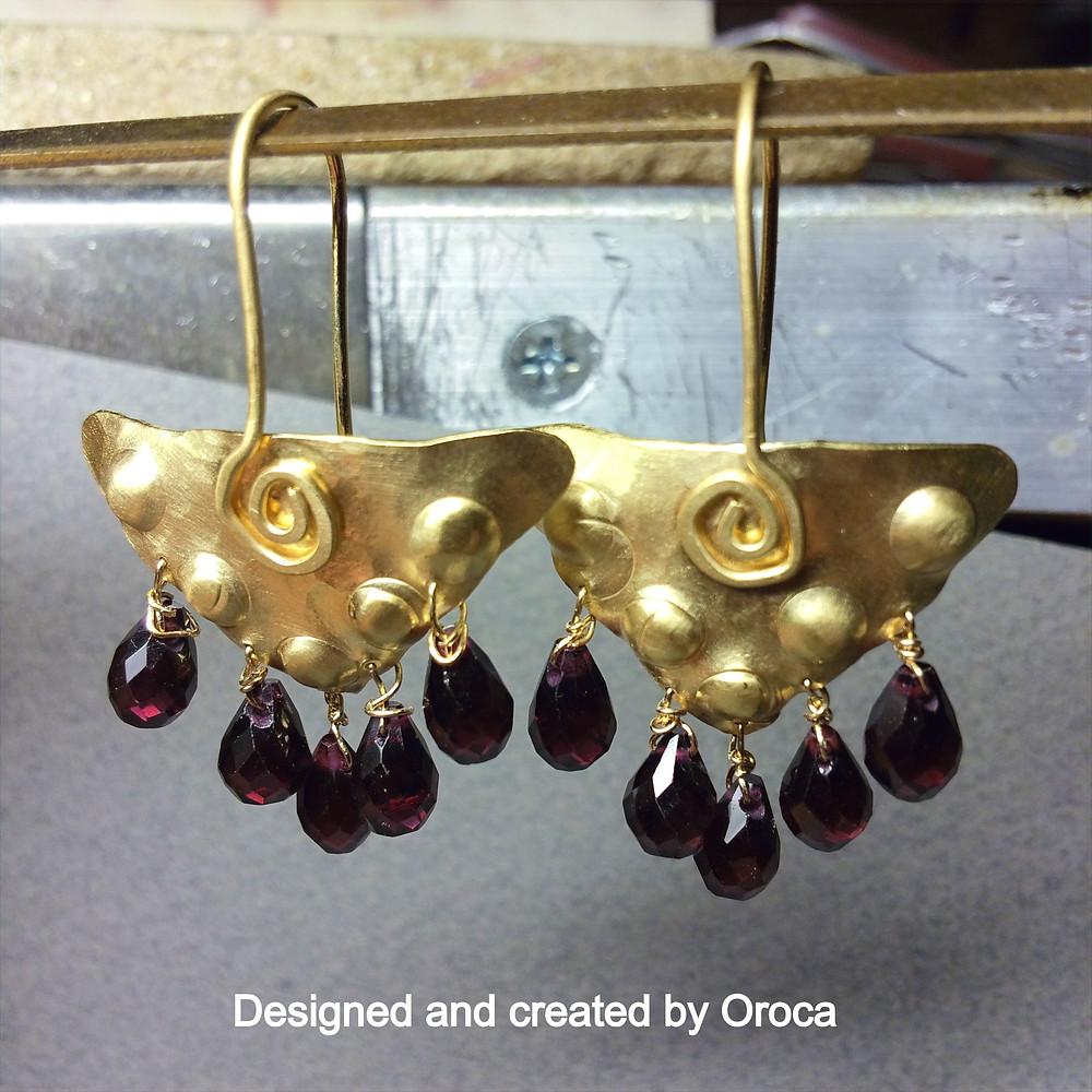 Earrings with garnet drops