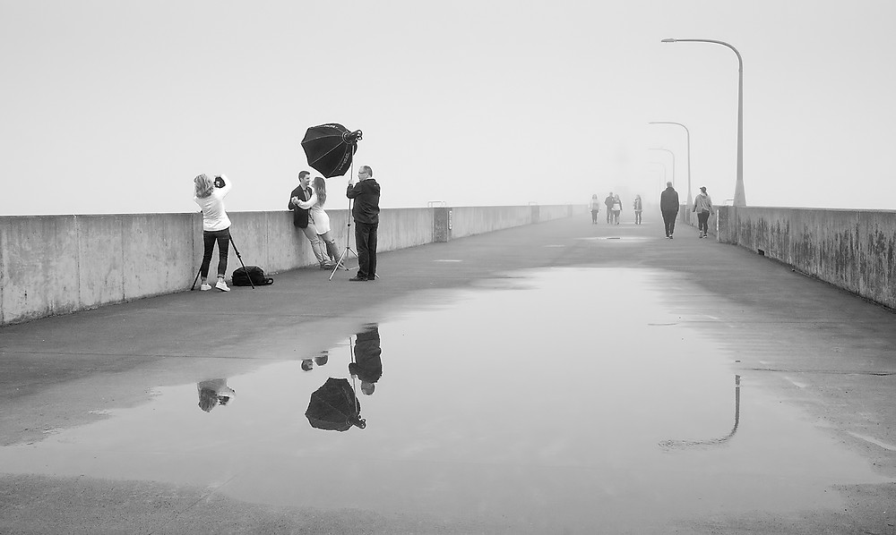 It was a foggy morning in Duluth and I noticed this couple having their pictures taken. I followed discreetly for some time and finally got this image of the shoot on the pier leading out to the lighthouse. f8, 1/60, ISO 1000