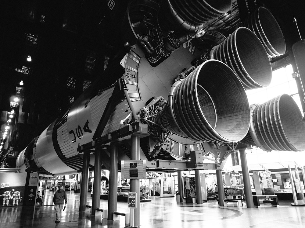 Saturn V engines with a person for scale, wide view