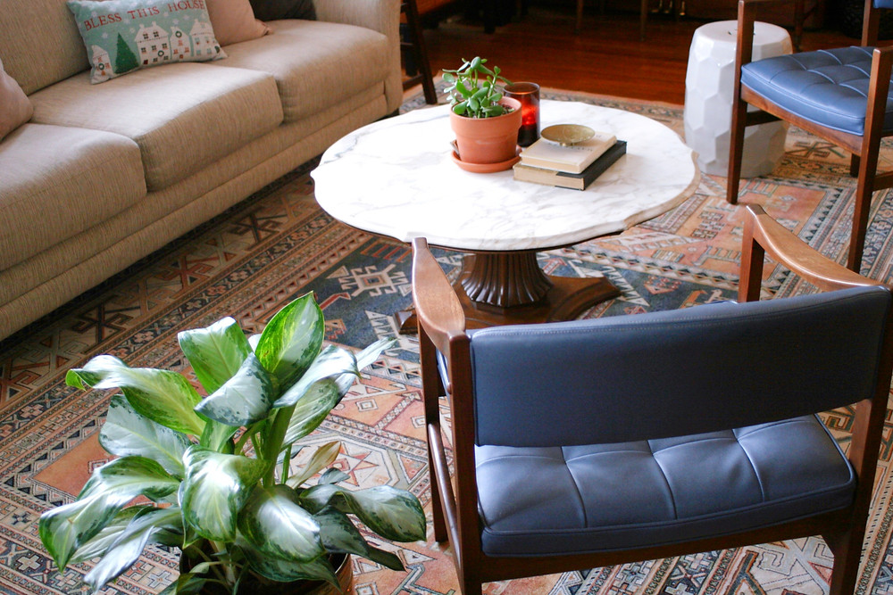An image of Lauren Figueroa's living room decorated with plants, candles and books.