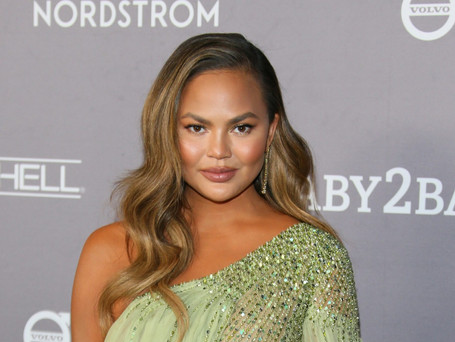 Chrissy Teigen Considering a Breast Reduction