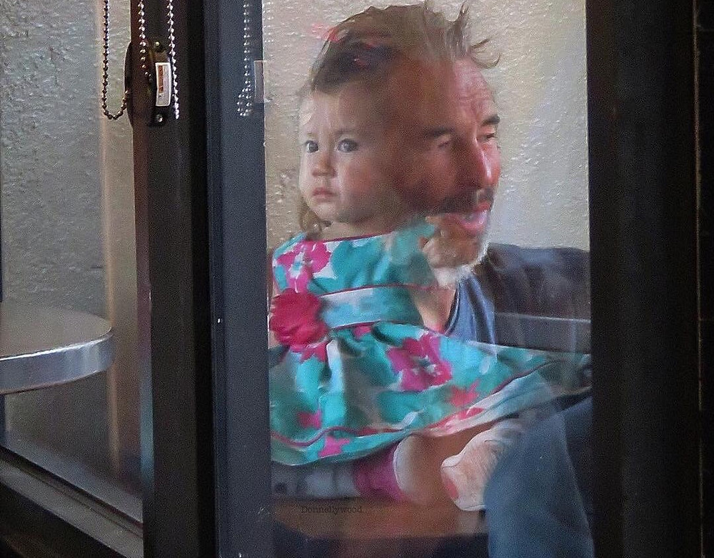 little girl looking through window in hollywood