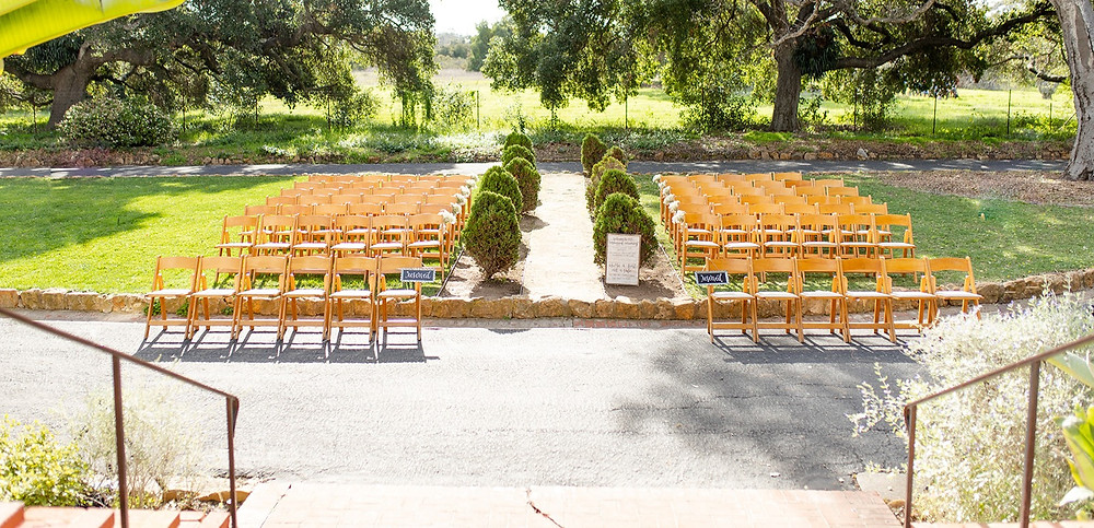 empty seats at a wedding ceremony at Rancho La Patera and Stow House in Santa Barbara, CA