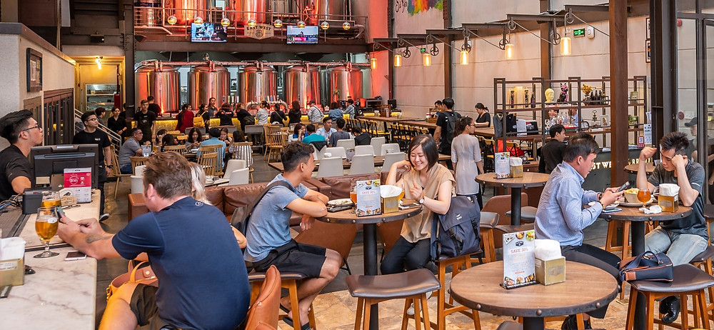 """Saigon's East West Brewing Company taproom is seeing a healthy return of customers"""