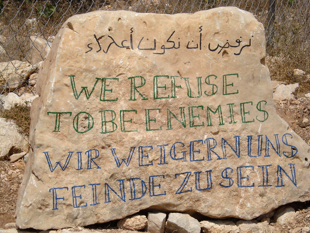 'We refuse to be enemies' sign outside the Tent of Nations