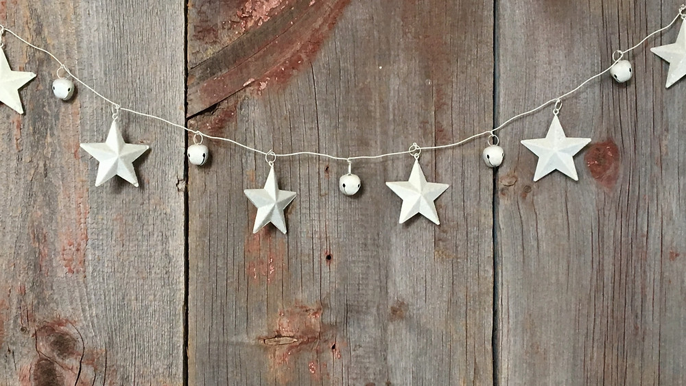 Stars on a string with a wooden fence behind