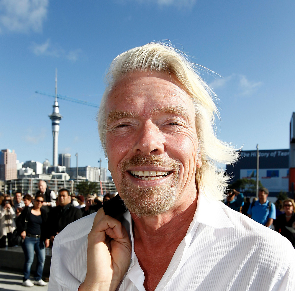 Sir Richard Branson with coat over shoulder