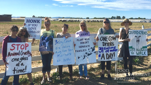 A group of people holding signs at an anti-dairy protest