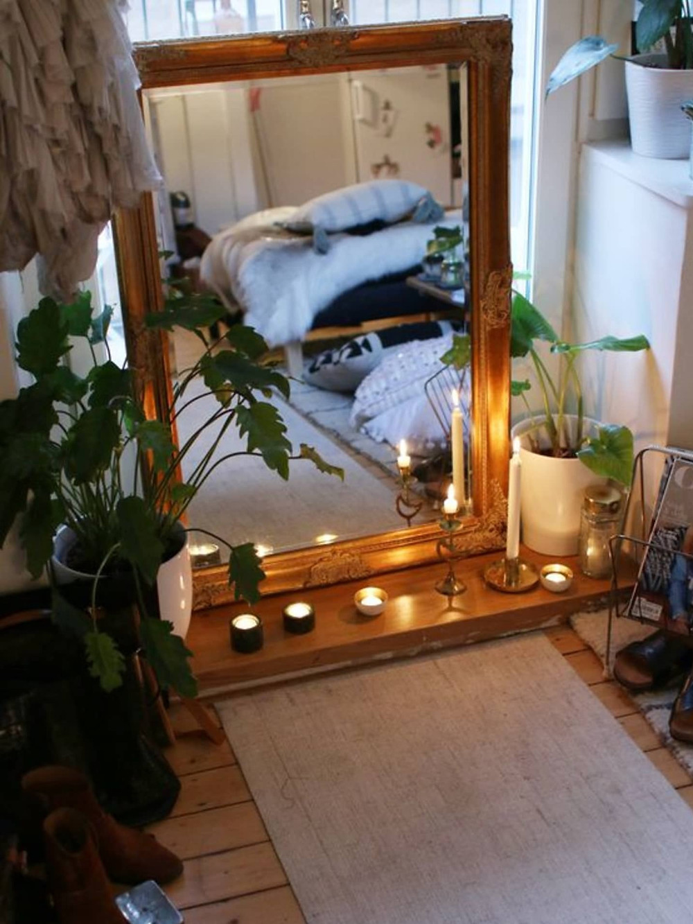 meditation corner with mirror and candles for yoga