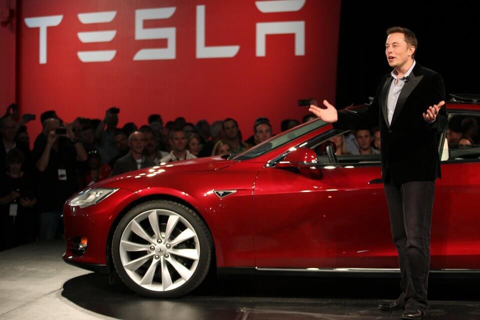 Elon Musk showcasing the new Tesla 3