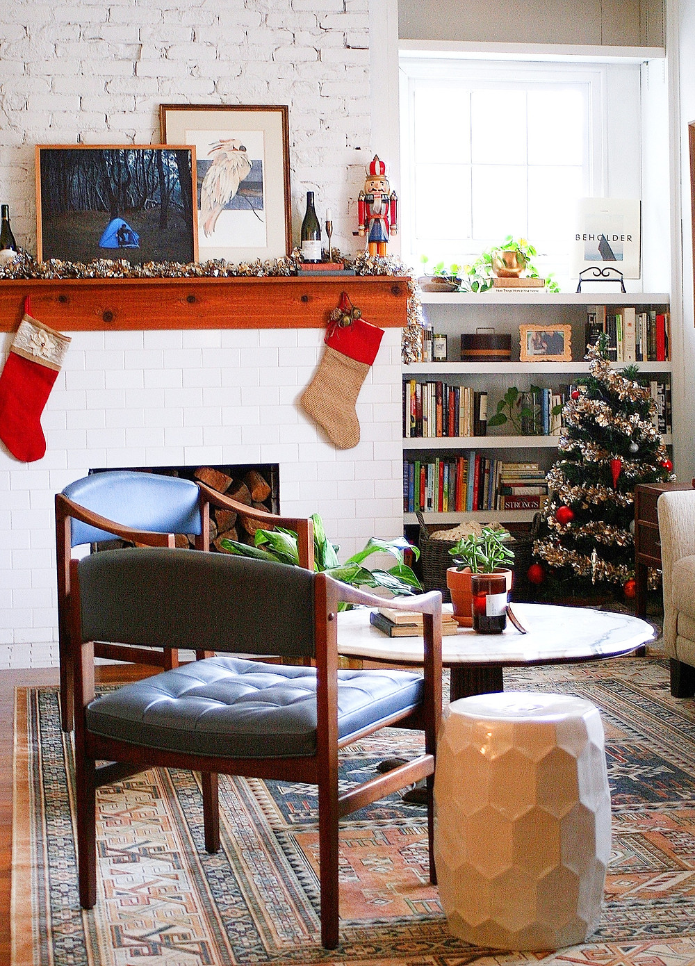 A shot showing the Christmas tree and mantel.