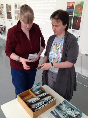 Illustrator Natalie Rowland showing a visitor some of the leaflets available at the show.