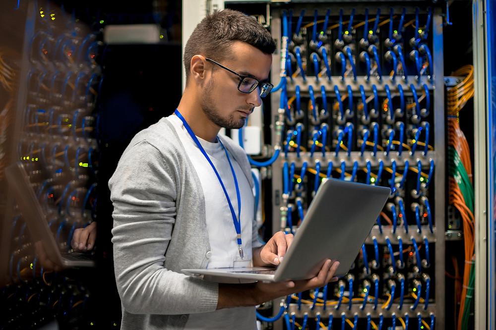 IT Technician working on laptop