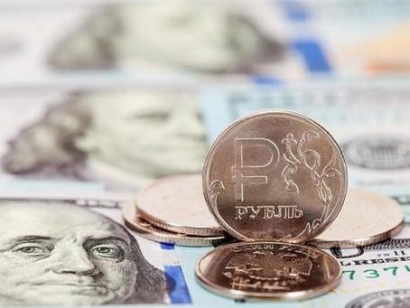 Рубль завершил основную валютную сессию ослаблением к доллару и евро