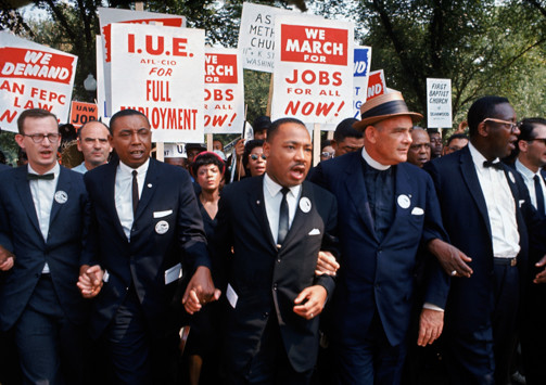Color photo of Martin Luther King, Jr. and other organizers of the March on Washington for Jobs and Freedom in 1963.