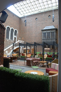 Dining area at the Detroit Institute of Arts, al fresco feeling with green hedges and a cathedral skylight roof.
