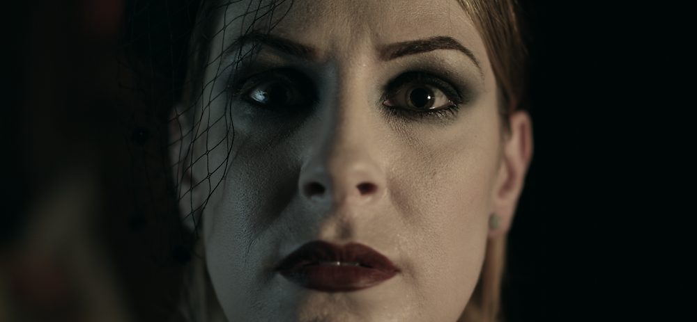 Still from Dual Action showing protagonist Elyse Price.