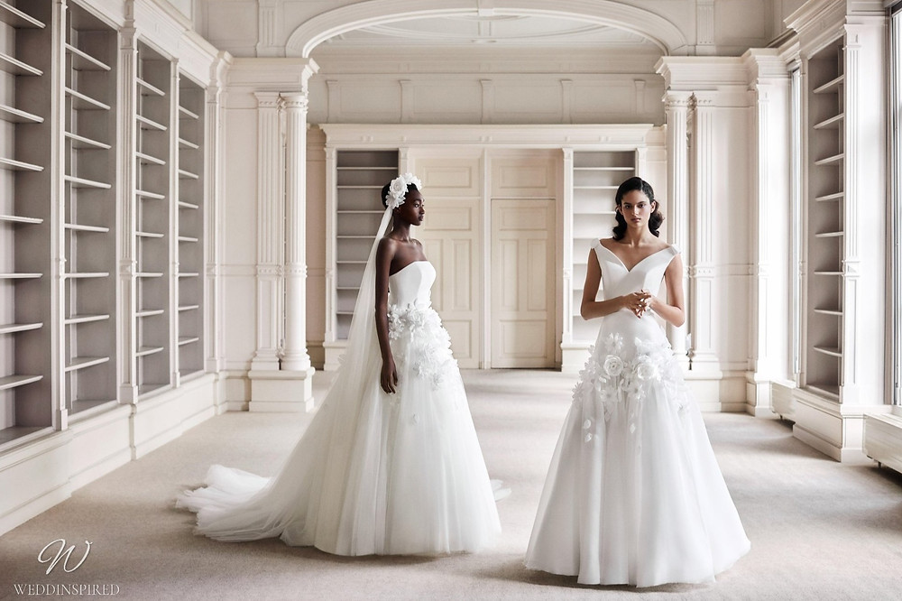A Viktor & Rolf 2021 off the shoulder princess ball gown wedding dress with a tulle skirt and flowers