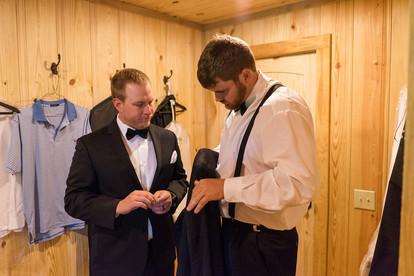 auburn groom getting ready in venue