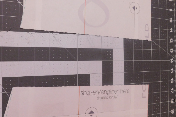Image shows the bodice piece of the Dream Tee pattern cut into two pieces along the shorten/lengthen line.