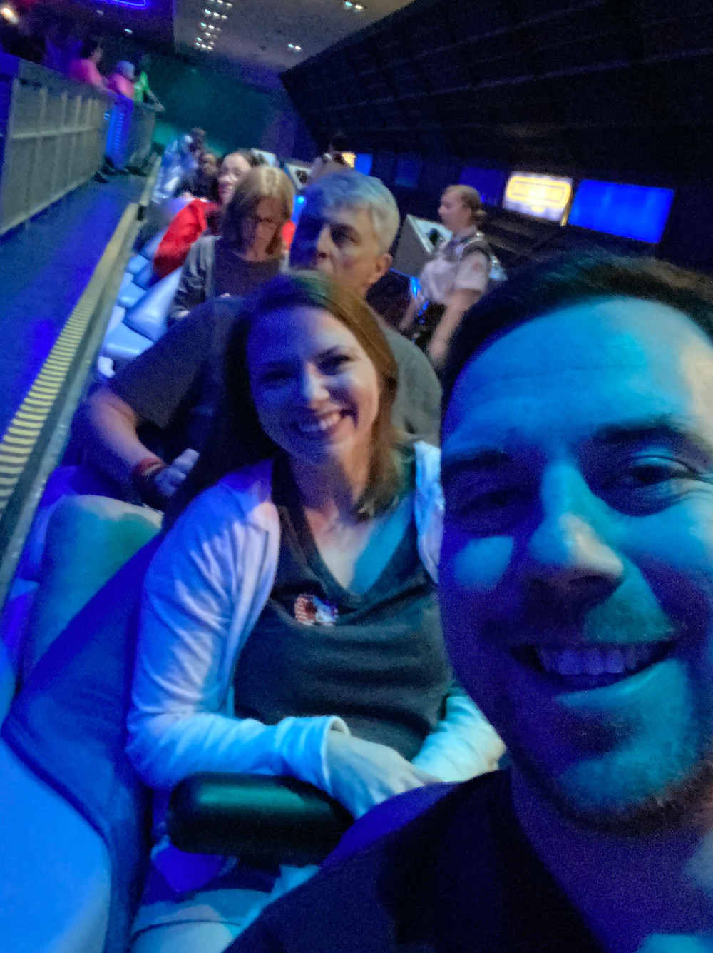 People in the ride vehicles for Space Mountain in Tomorrowland