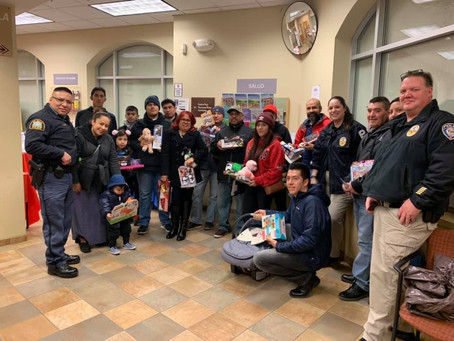 NLPOA Members handed free Christmas gifts to families at the Mexican Consulate