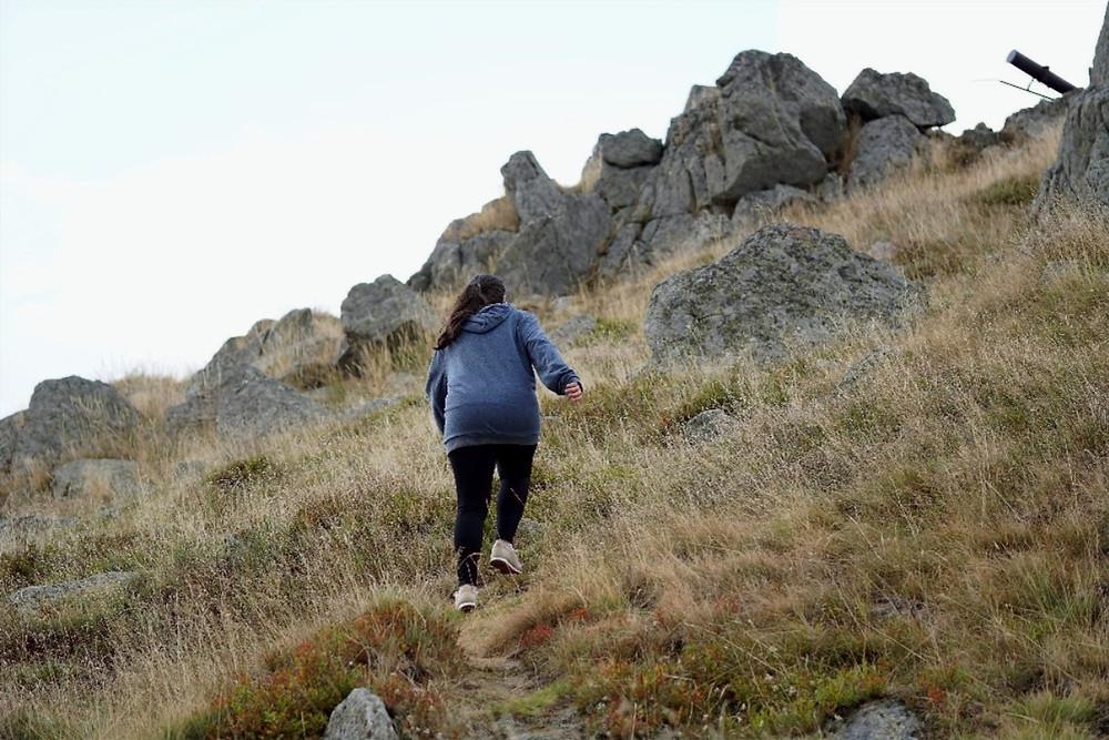 Women hiking uphill
