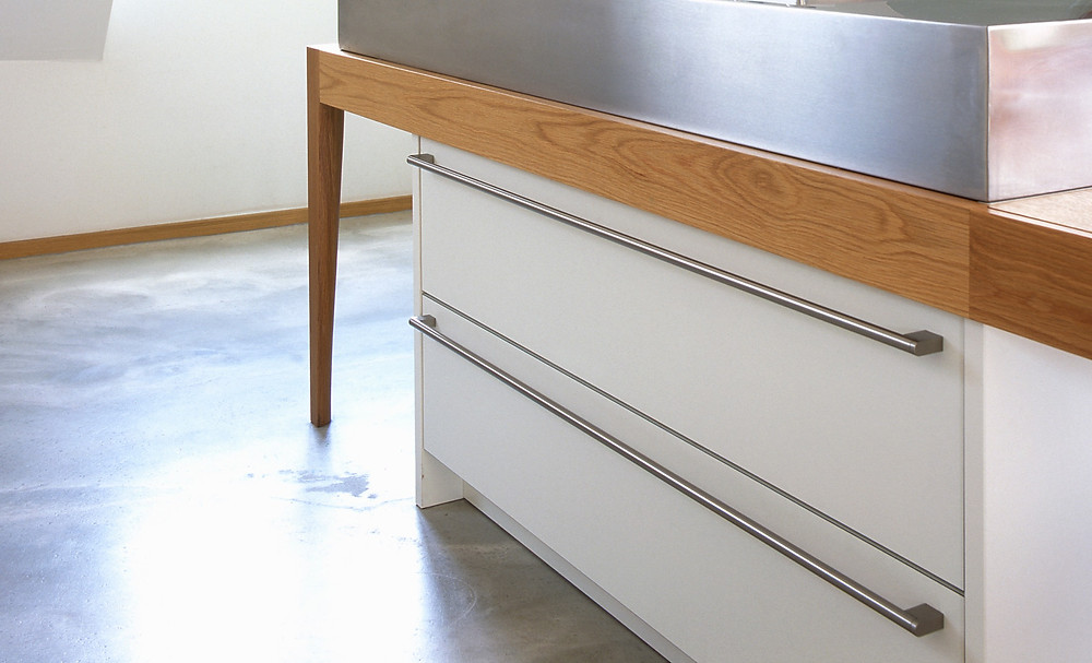 White pullout drawers under kitchen table