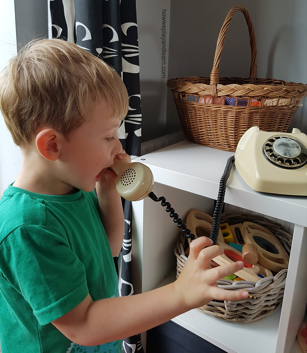 Child playing and learning with phone
