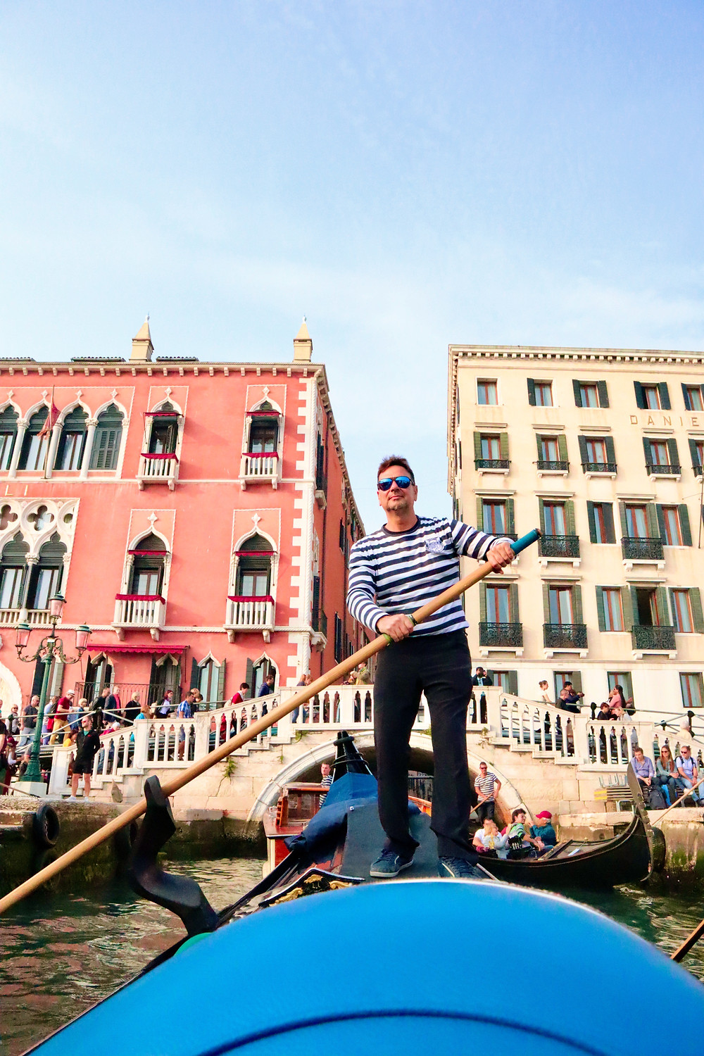 Gondolier in Venice, Italy by Biteinerary