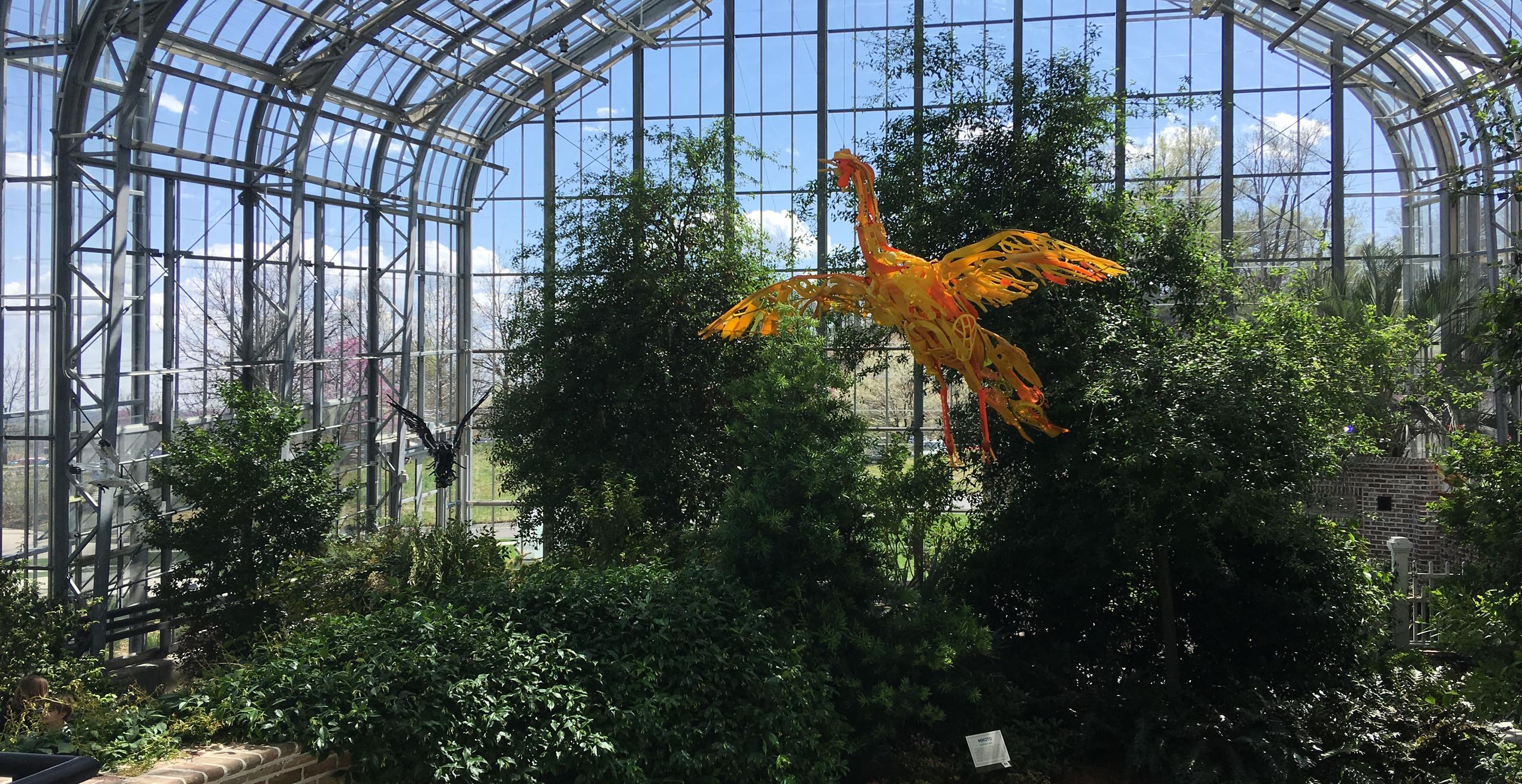 plastic phoenix in trees