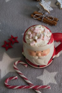 santa mug hot chocolate with lots of marshmallows and candy canes