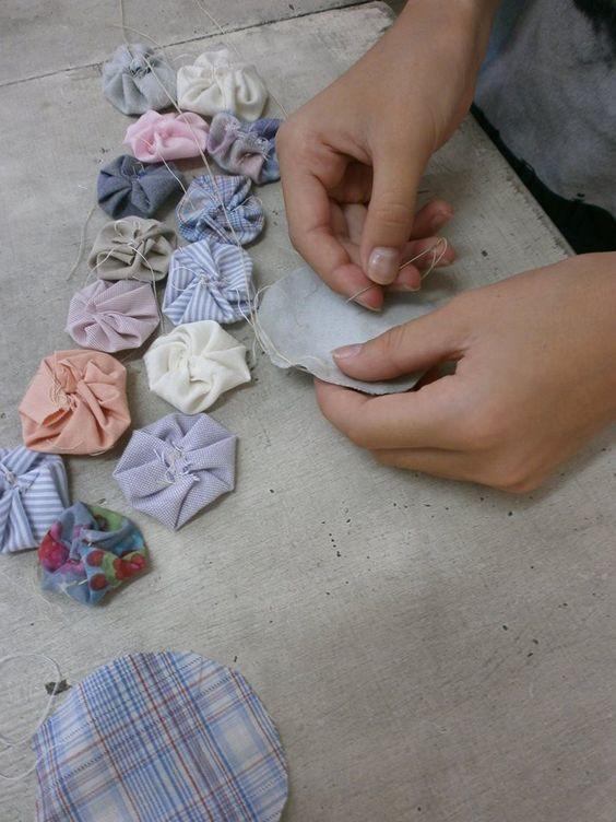 Girls and boys sewing yoyos