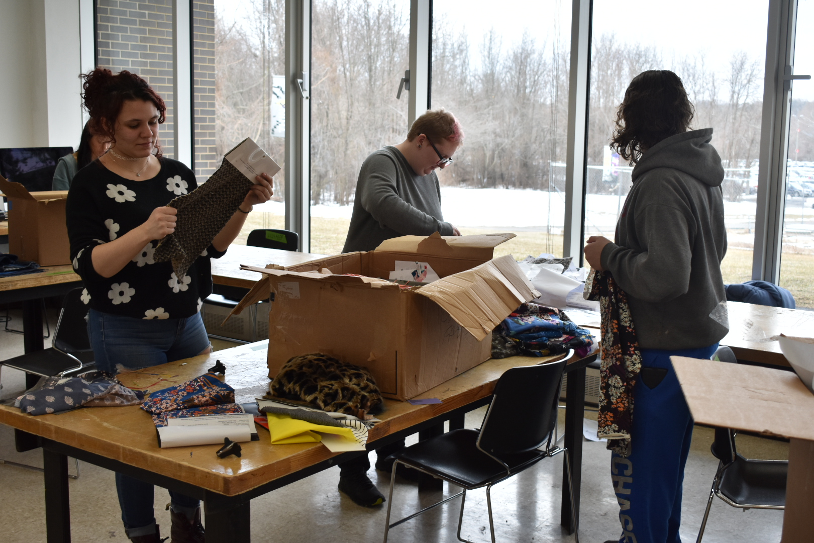 Students sort fabric. (Photo by Sierra Petro)