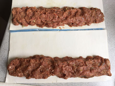 Left: Sausage roll mixture. Right: Two 1/2 sheets of frozen pastry, each with 1/8 meat mixture.