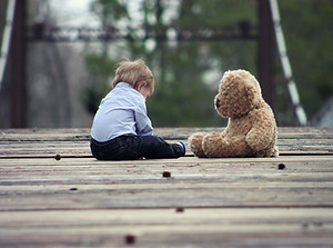 toddler with bear