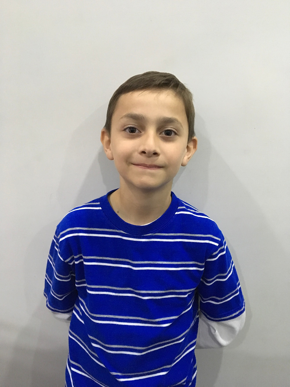 Omair is 8 years old, and in third grade. He enjoys math (especially multiplication drills and mental math) and English. Pizza, and peanut butter and jelly sandwiches are his favorite foods. His hobbies include video games and soccer. But he's afraid of the dark.