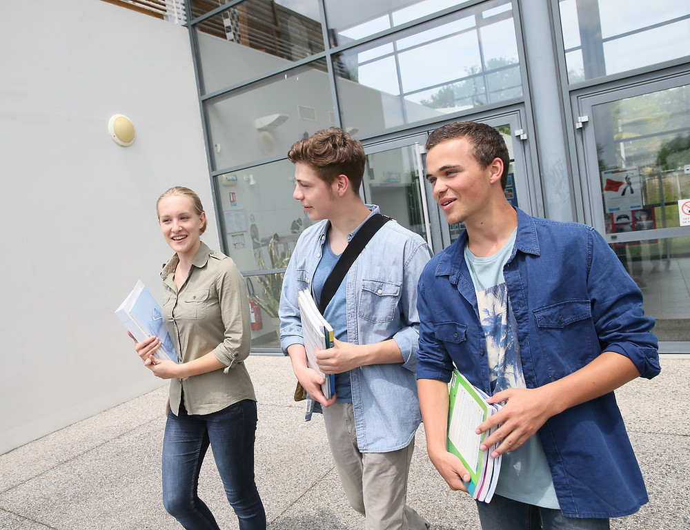 Three teenage students university open day walking campus The Parents' Guide to