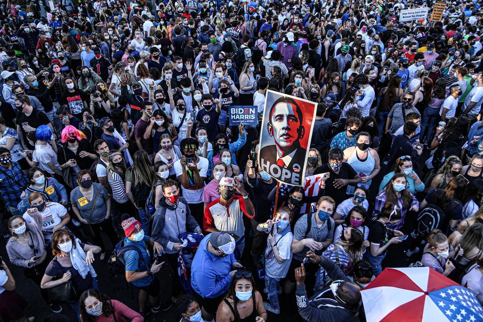 Young people flood the streets of Washington, D.C. minutes after Joseph Biden, Jr. defeats Donald Trump.