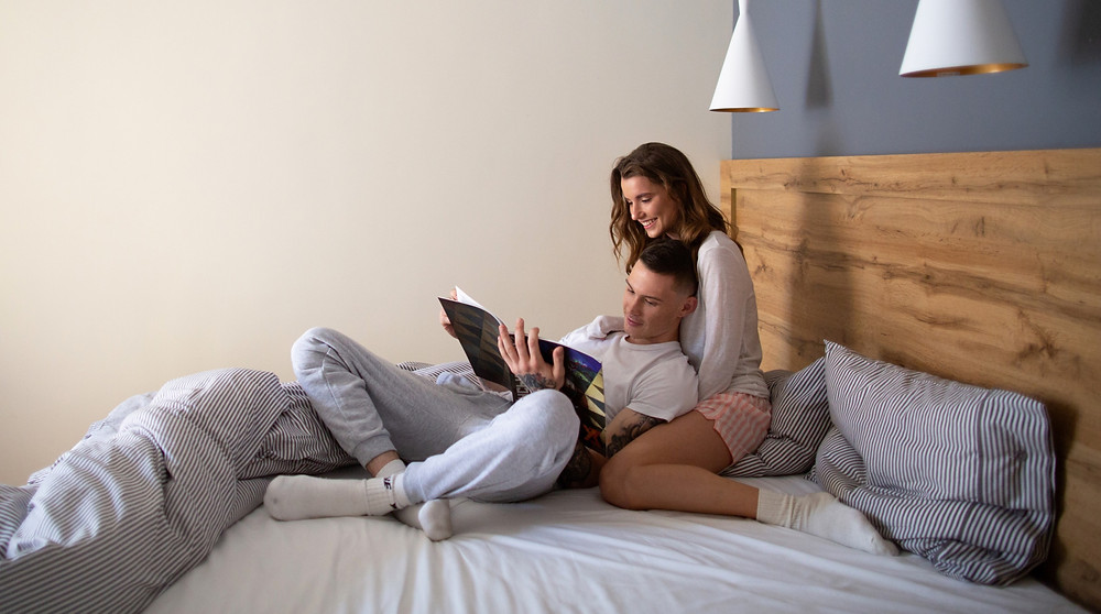 Couple in Bed Date Night Therapy