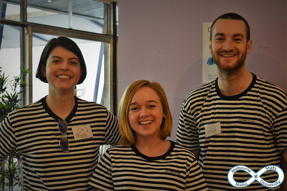 MUMS  committee members wearing black and white striped t shirts
