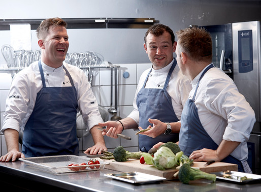 Three chefs around one oven