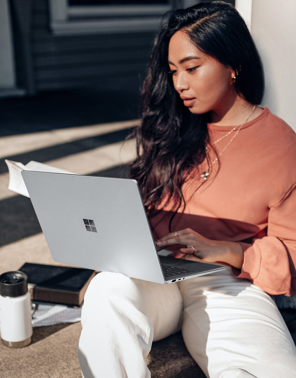 Teenage girl working on laptop outside: The Parents' Guide to