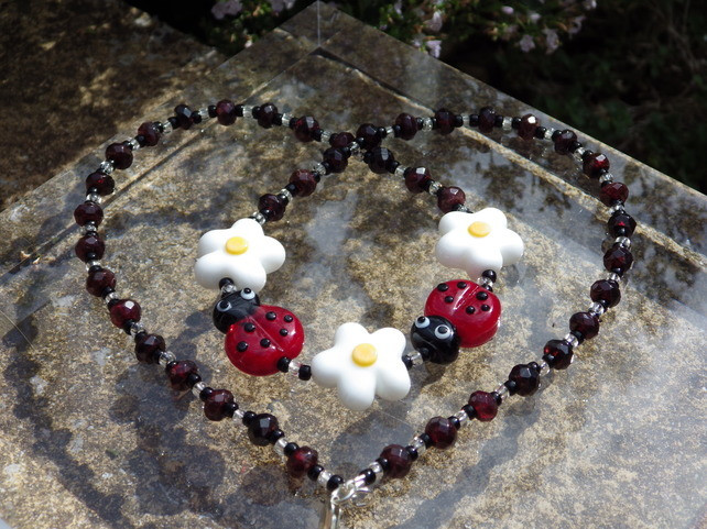 Necklace using lampwork glass beads teamed with garnet rondelle beads